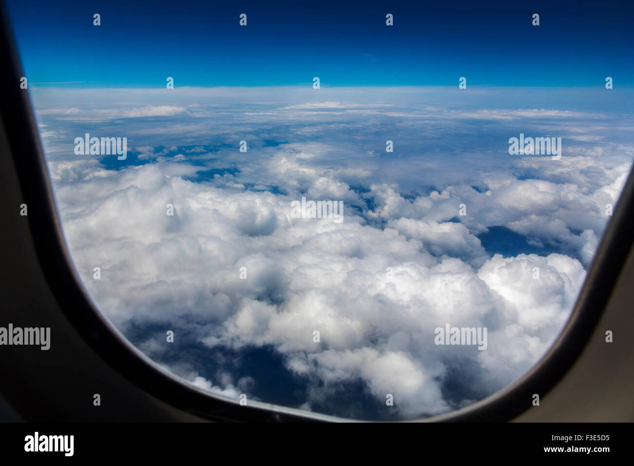 Clouds blue sky window airliner - Stock Image