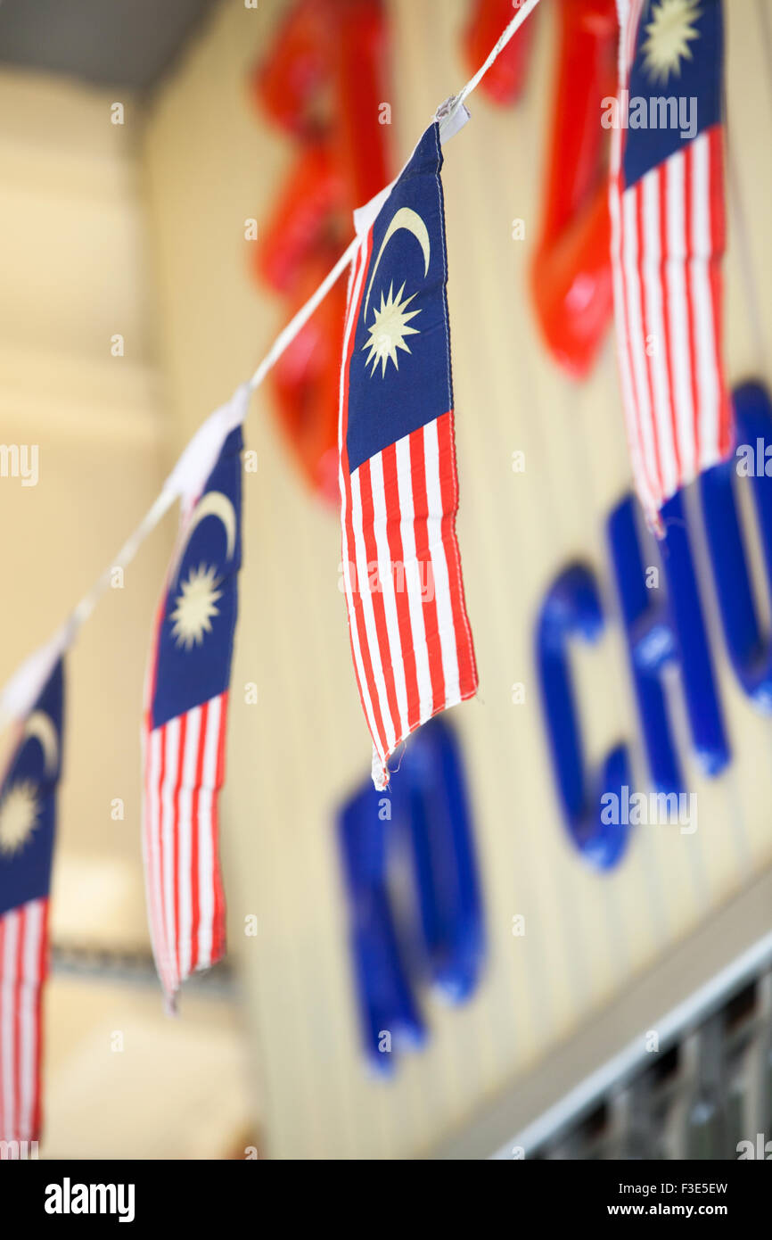 Penang, Malaysia - 03 August 2014: The Garland of Malaysian flags on the street, Penang, Malaysia on 03 August 2014. - Stock Image