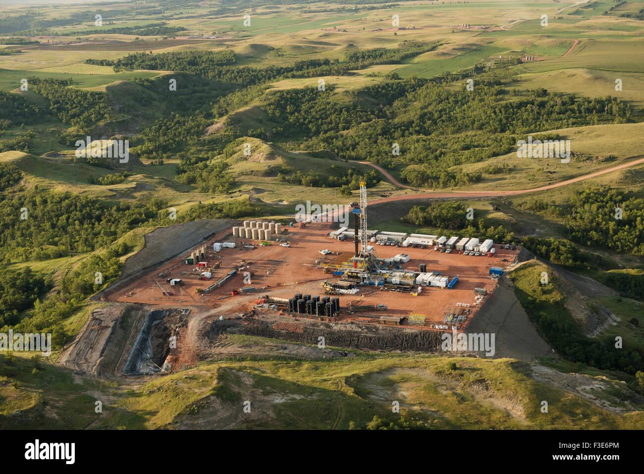 Oil development in the Bakken Formation among the bluffs of the Little Missouri River, North Dakota. - Stock Image