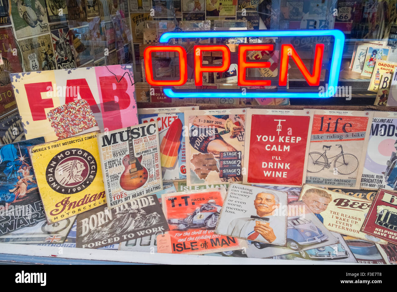 Shop window display of nostalgic posters, with neon 'Open' sign. - Stock Image