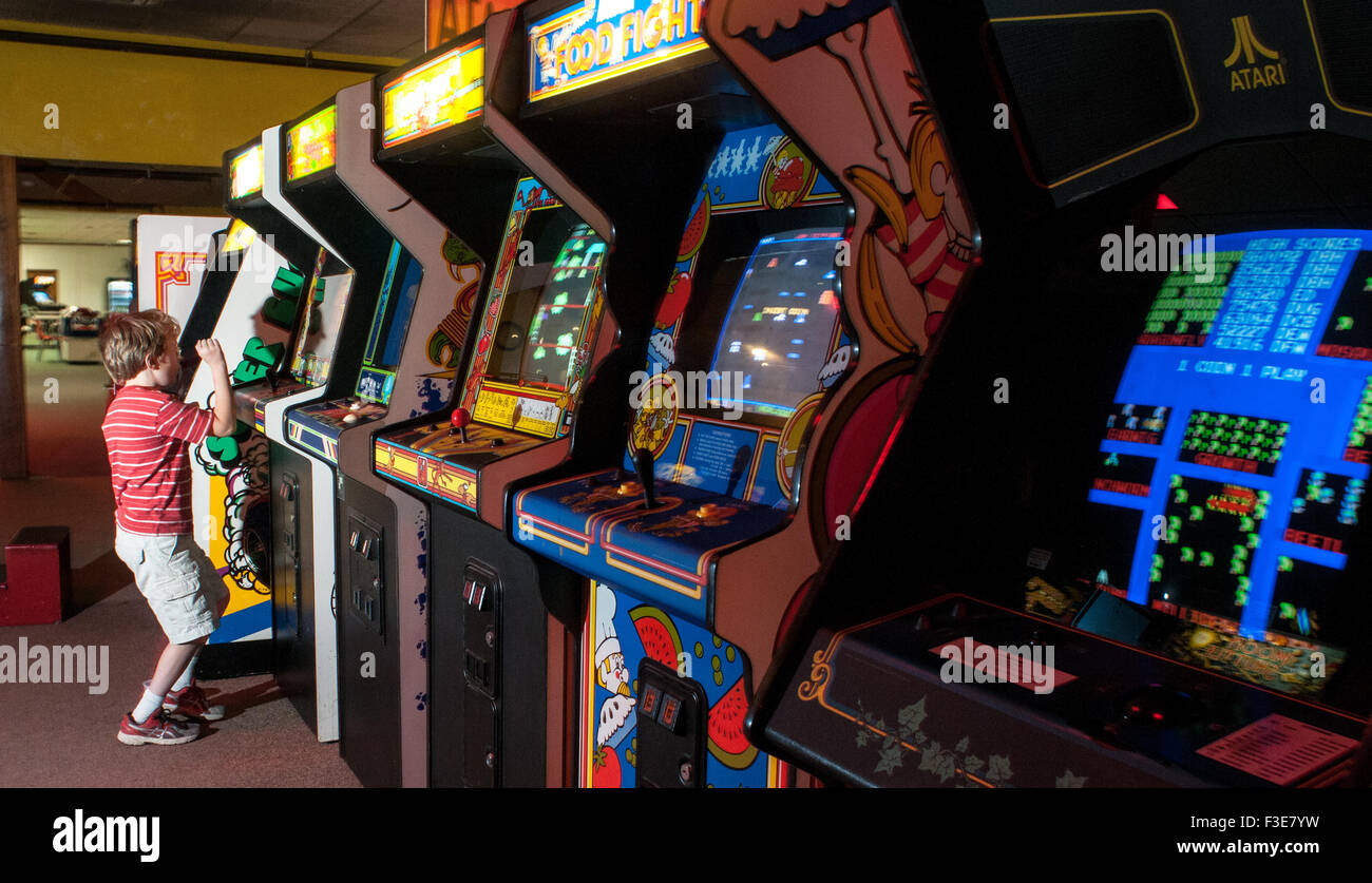 A boy celebrates advancing to the next level on a video game at the American Classic Arcade Museum in Laconia, New - Stock Image