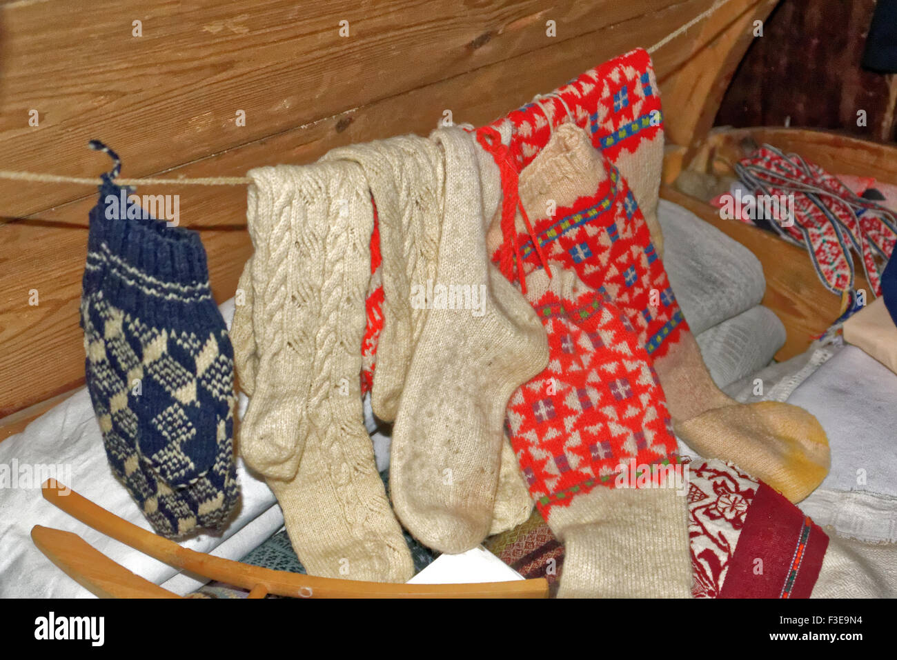 Homemade knitted socks in a a rustical bedroom in Setomaa. - Stock Image