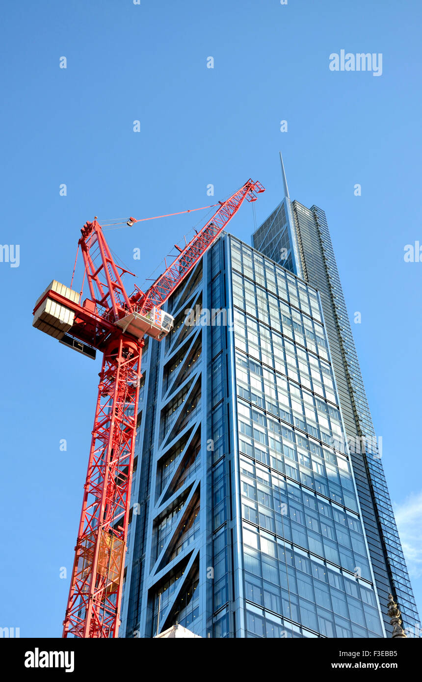 London, England, UK. Large construction crane and modern office block in the City Stock Photo