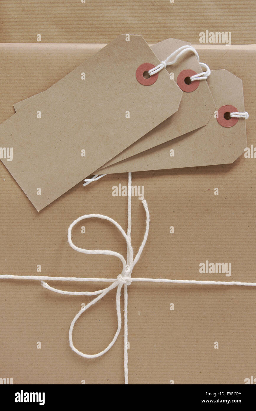 Parcel packing brown parcel paper labels and string - Stock Image