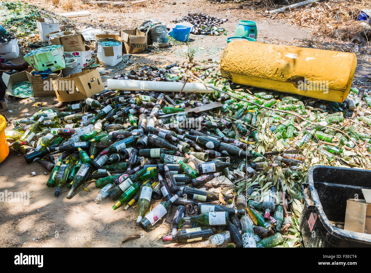 Pile of dusty empty beer and wine bottles at Katundu creative trade workshop, Likoma Island, Lake Malawi, Malawi, Stock Photo