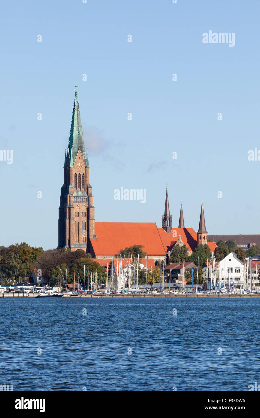 Schlerwig Cathedral and marina on the Schlei inlet - Stock Image