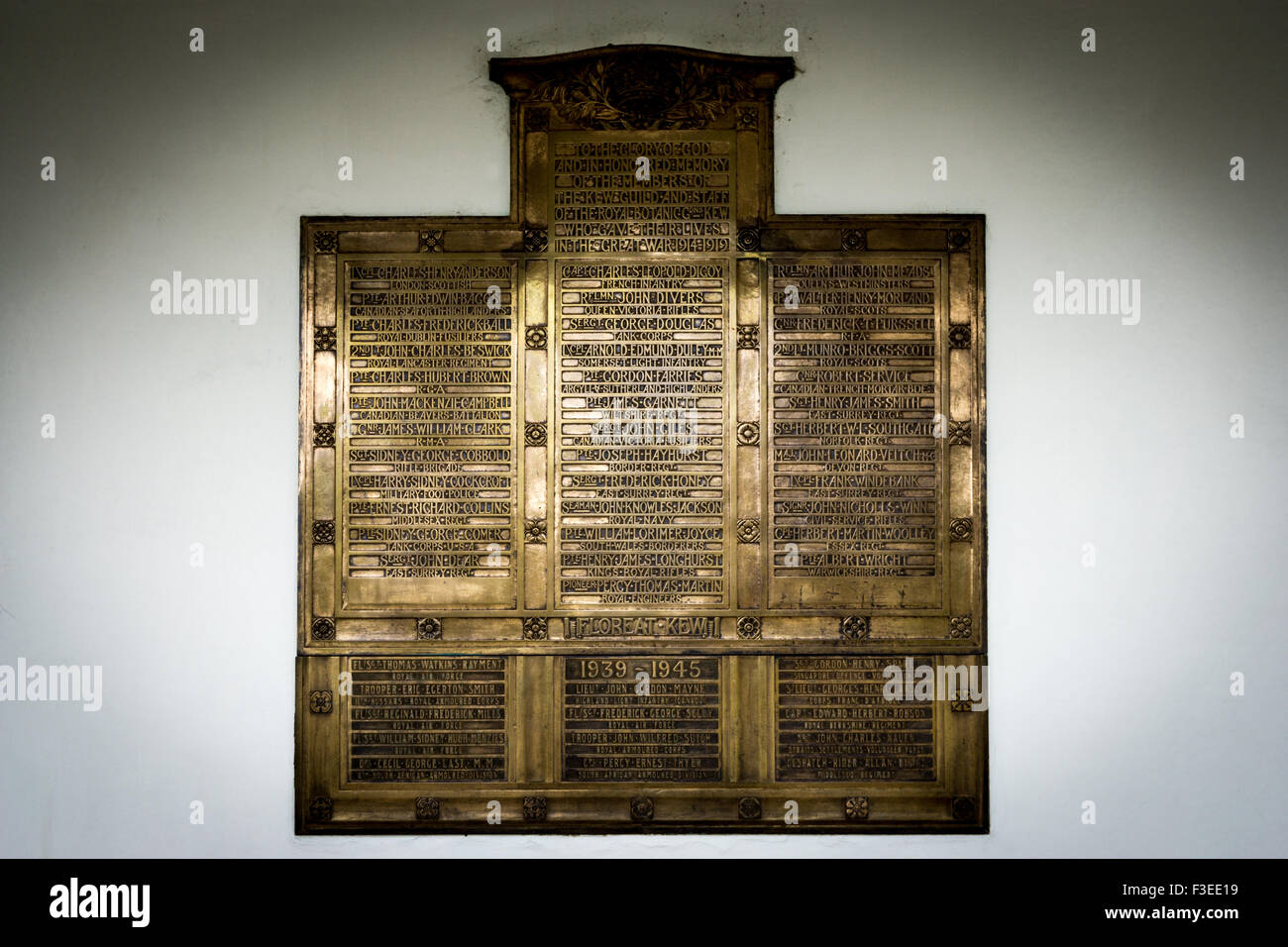 A memorial plaque commemorating the dead of the two world wars. It is a bronze tablet designed by Sir Robert Lorimer - Stock Image
