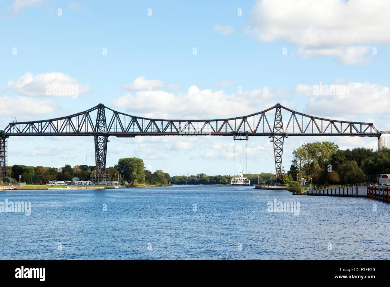 Rendsburg High Bridge with its suspension ferry across the Kiel Canal - Stock Image