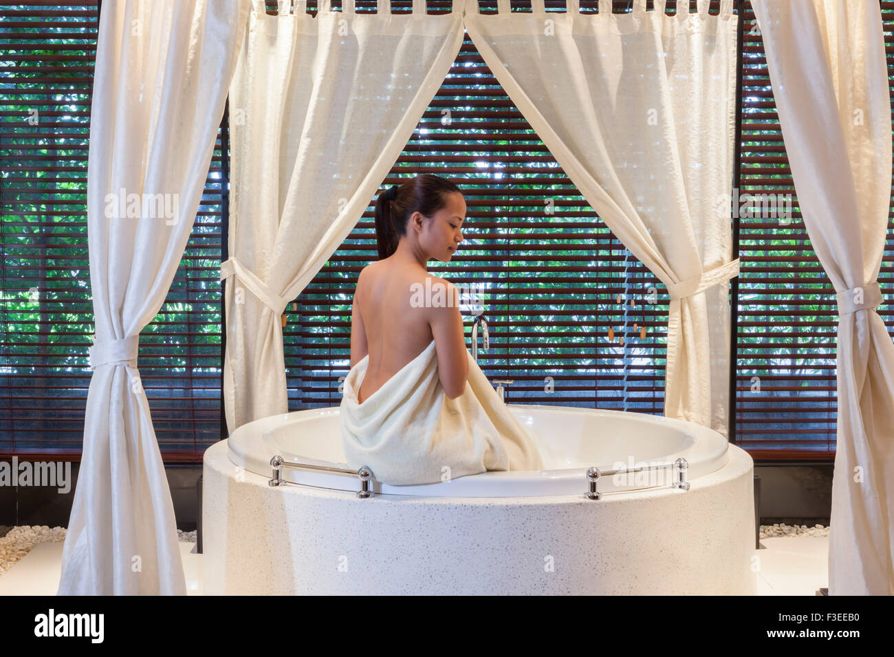 A young Asian woman in a spa - Stock Image