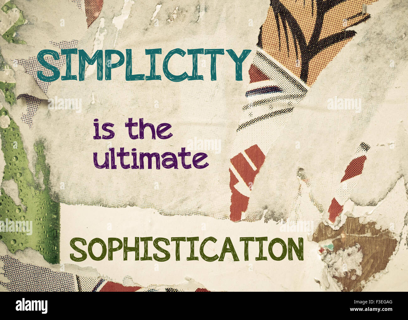Simplicity is the Ultimate Sophistication- Inspirational message written on vintage grunge background with Old Torn - Stock Image
