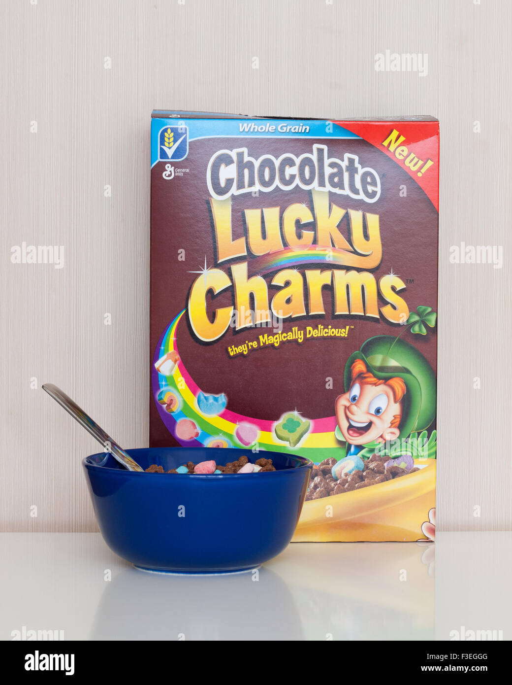 A box and bowl of Chocolate Lucky Charms cereal, manufactured by General Mills. - Stock Image
