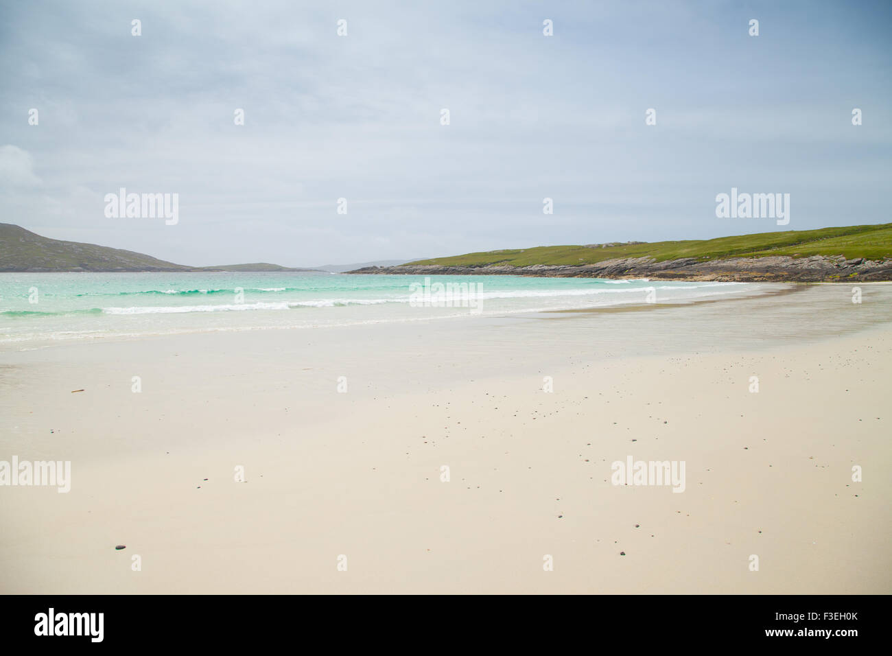 Looking South from the tip of Vatersay  over a white beach, Outer Hebrides Scotland - Stock Image