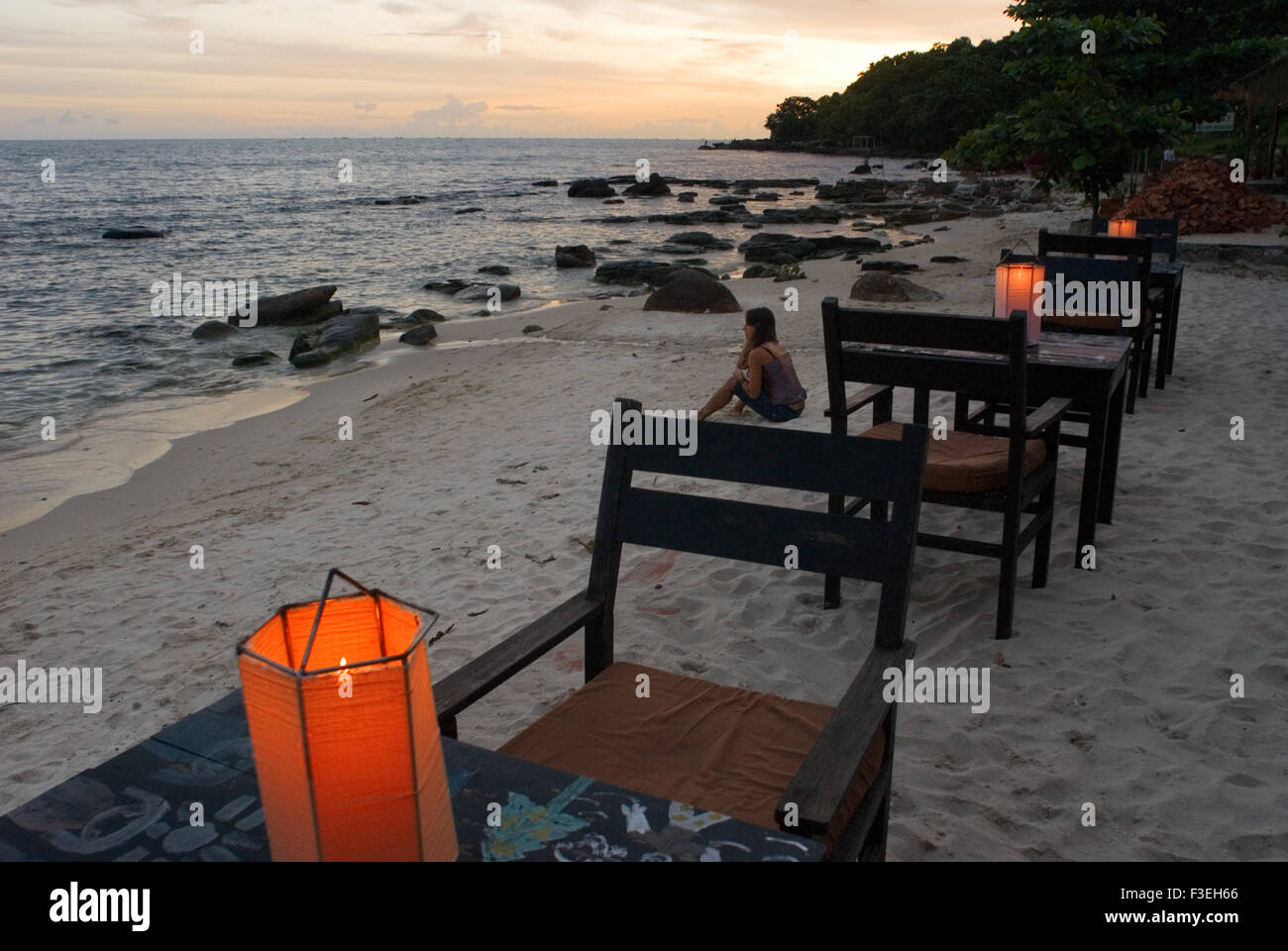 Tables of some of the restaurants on the beach. Sihanoukville beach. Some of these Sihanoukville beaches are crowded - Stock Image