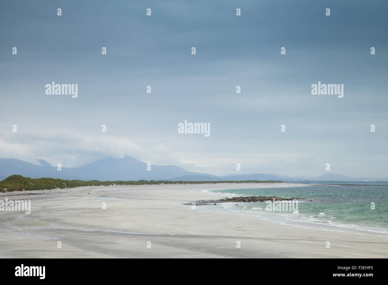 The white sands of a beach on the west coast of South Uist, Outer Hebrides Scotland. - Stock Image