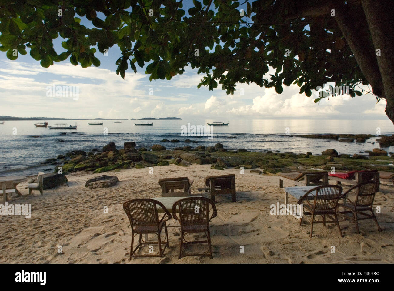Tables of some of the restaurants on the beach. Sihanoukville beach. Sihanoukville has a different look and feel - Stock Image
