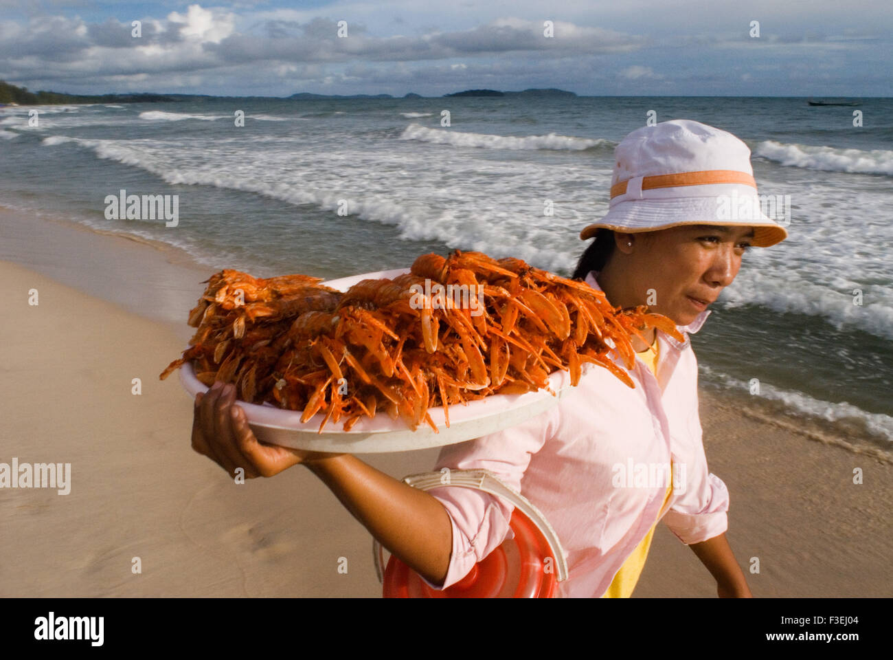 Selling crayfish in Sihanoukville beach. Arriving in Sikanouville after an easy 4-hour bus ride with Mekong Angkor - Stock Image