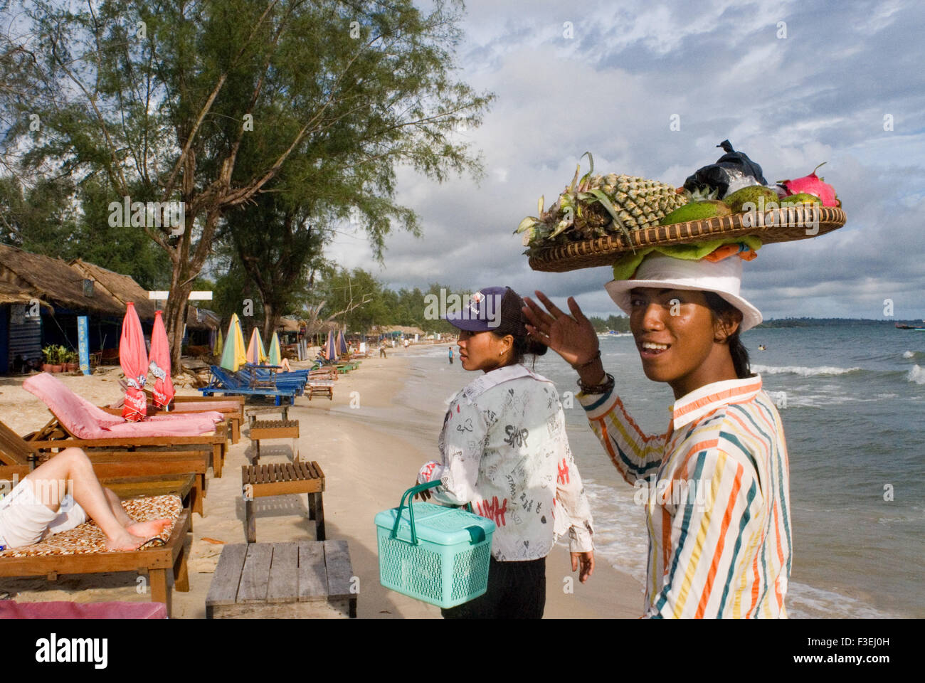 Fruit sellers on the beach in Sihanoukville. Sihanoukville, it's the 4th largest city in Cambodia but it's really - Stock Image