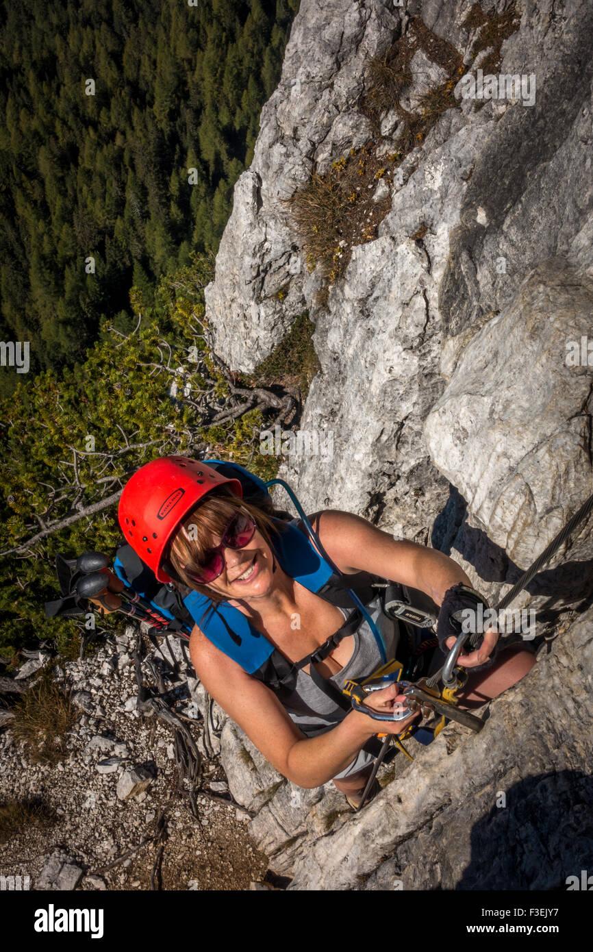 Climber on steep section of the Ettore Bovero via ferrata, Cortina (Dolomites, Italy) - Stock Image