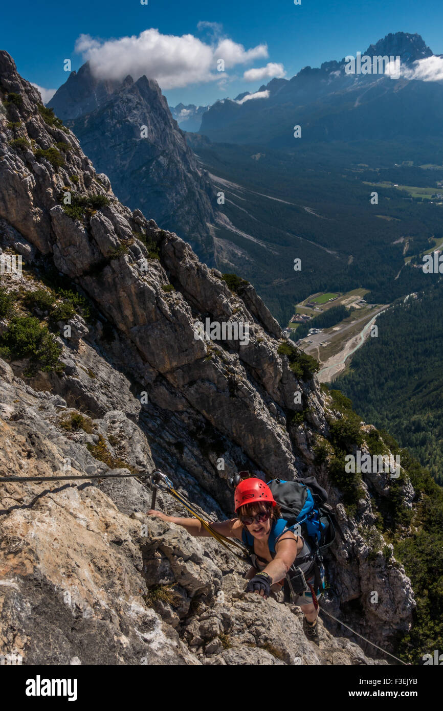 Climber on the Ettore Bovero via ferrata, with views looking towards Cortina in the valley from Col Rosa,  (Dolomites, - Stock Image