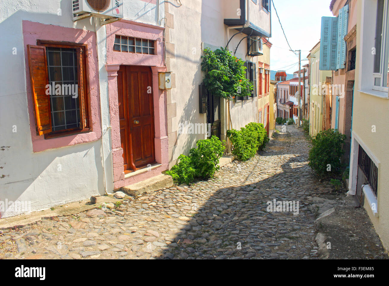 A narrow street of old touristic town, Cunda Alibey Island, Ayvalik. It is a small island in the northwestern Aegean - Stock Image