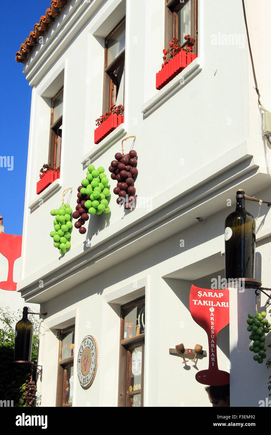 The exterior of the wine house is decorated with grapes in Bozcaada, Canakkale, Turkey - Stock Image