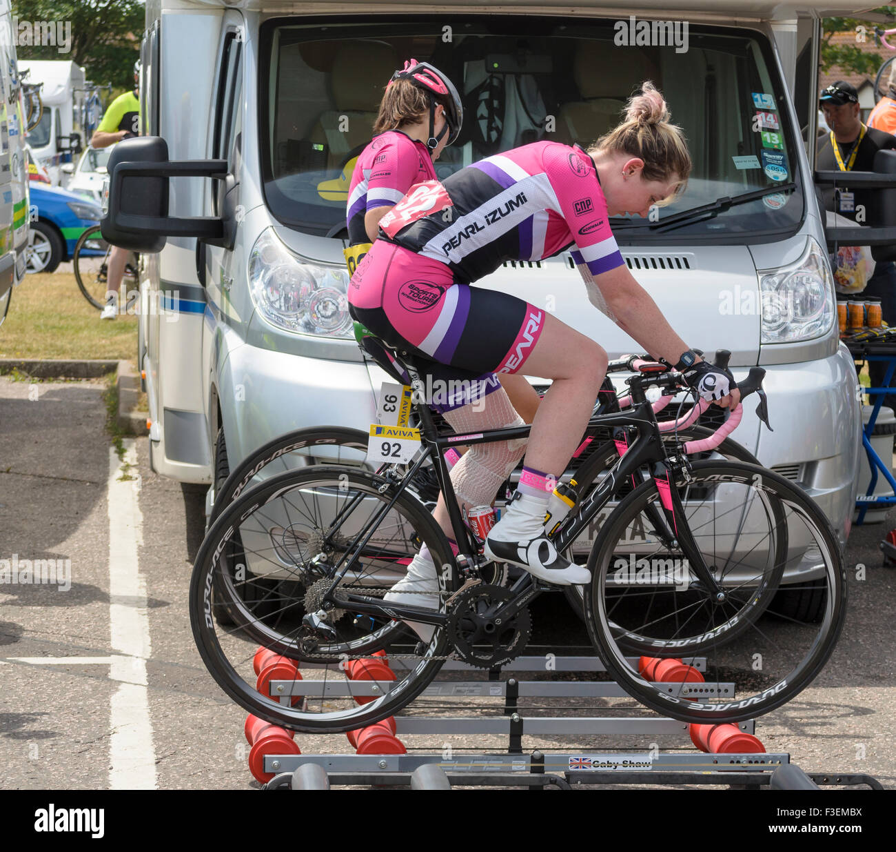 Two women cyclist warming up before the race, England UK. - Stock Image