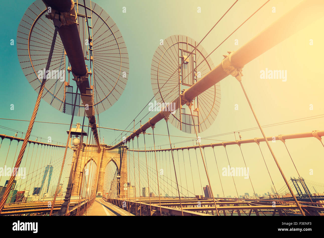 Vintage toned fisheye lens picture of Brooklyn Bridge in New York City, USA. - Stock Image