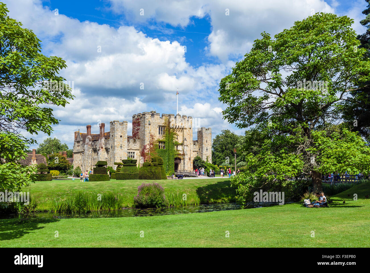 Couple having a picnic in front of Hever Castle, family home of Anne Boleyn, Hever, Kent, England, UK - Stock Image