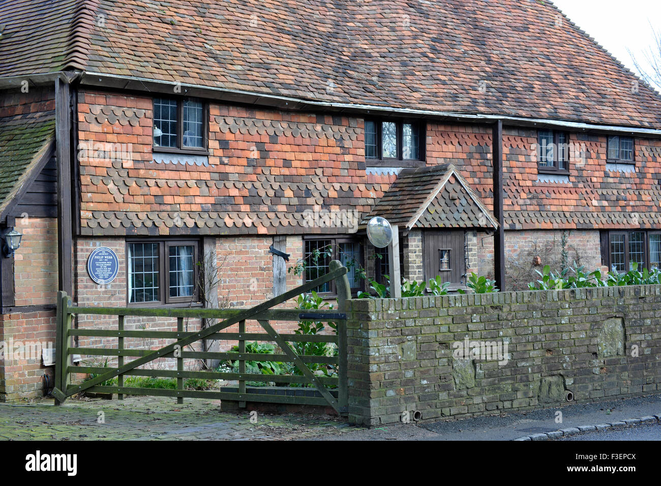 Blue plaque for Philip Webb at Turners Hill Road, Pound Hill, West Sussex, England, UK. - Stock Image