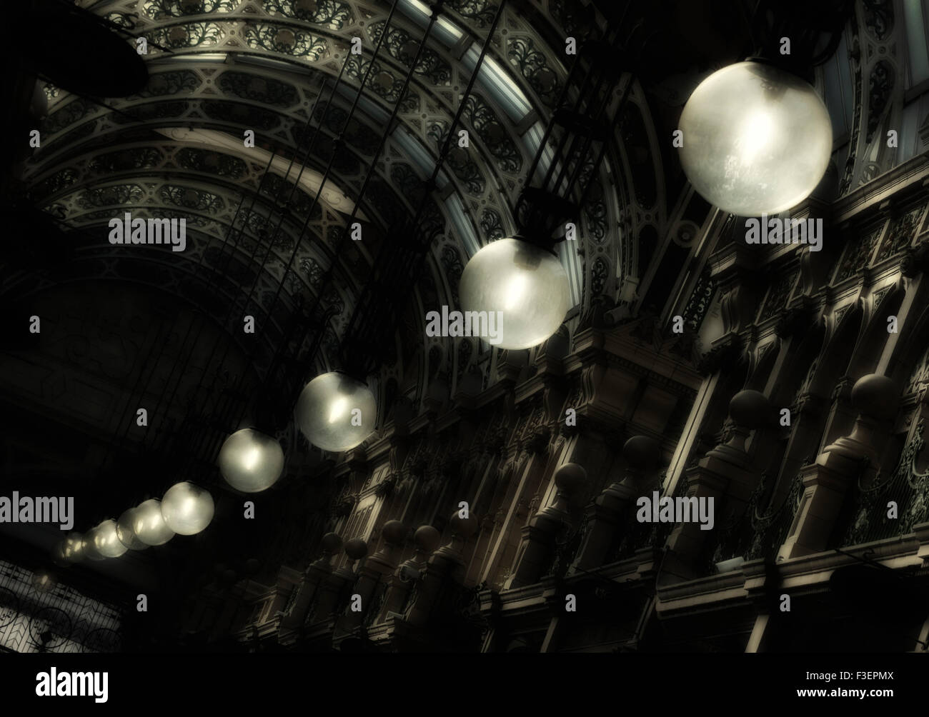 Lights glowing in the County Arcade, Victoria Quarter, Leeds, Yorkshire, England, UK. - Stock Image
