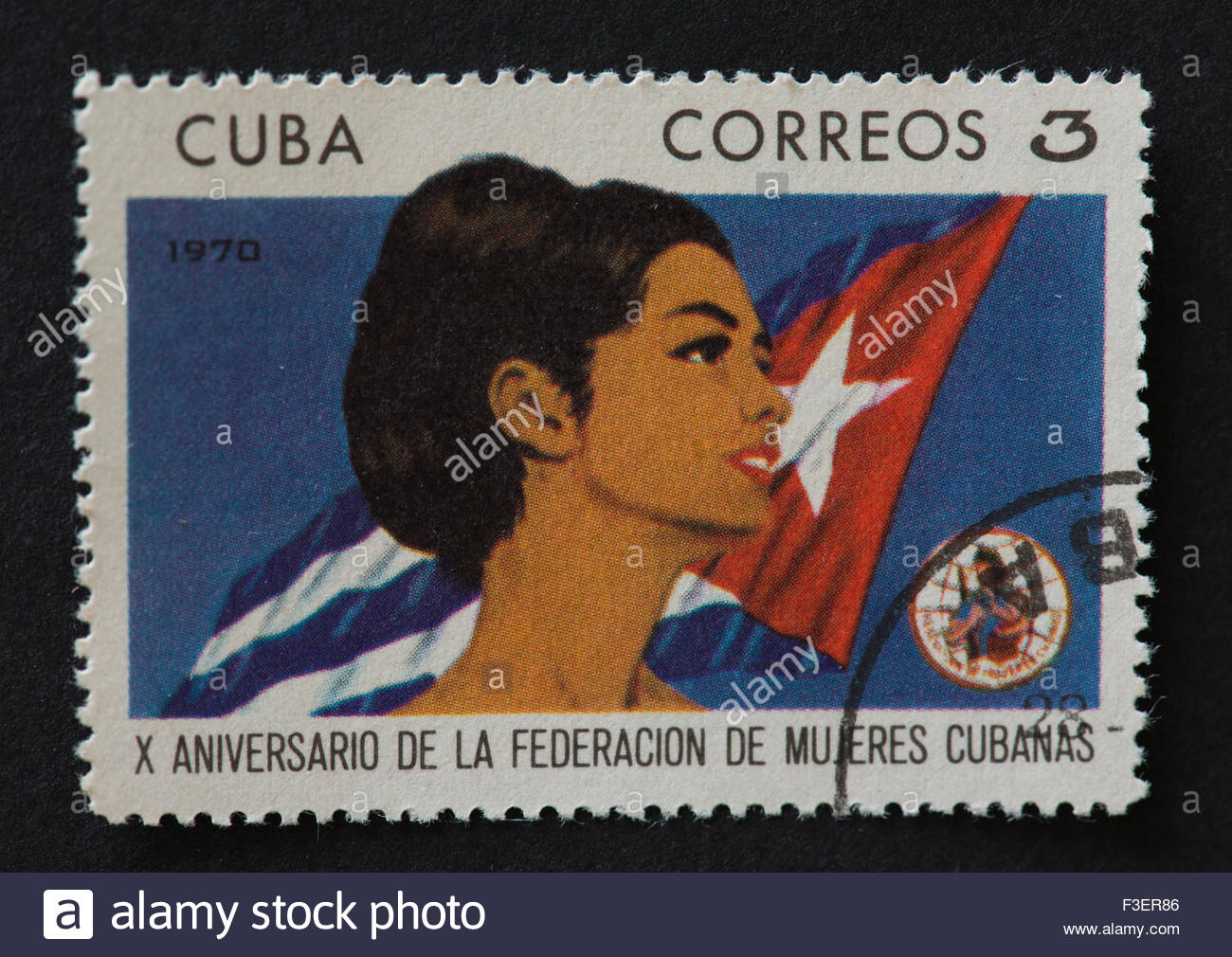 Cuban postage stamp celebrating the 10th anniversary of the foundation of the FMC or Cuban Women Federation.  A - Stock Image