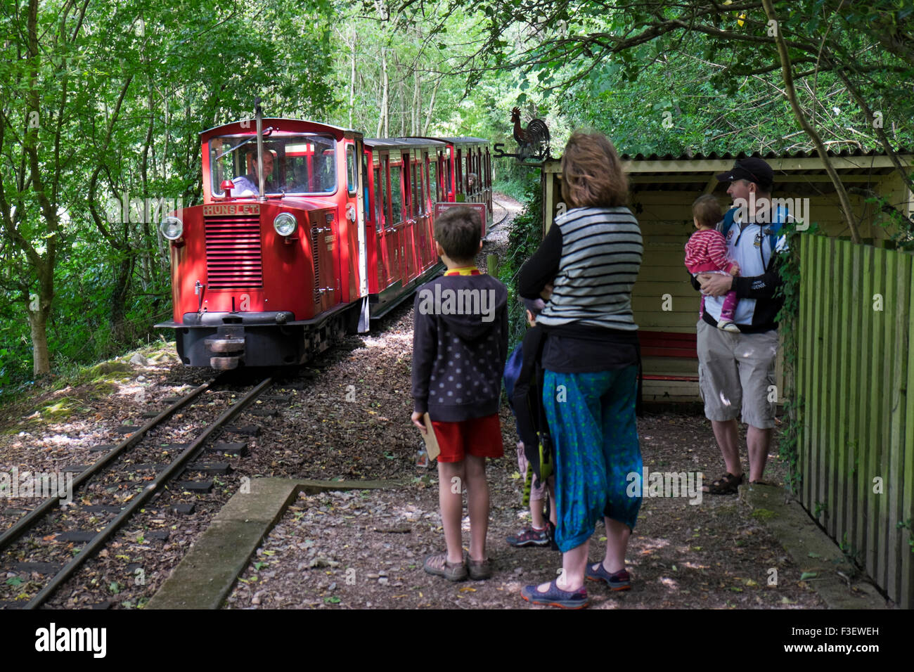 Family waiting for the train at Perrygrove Railway and Treetop Adventure, Coleford, Forest of Dean, England, UK - Stock Image