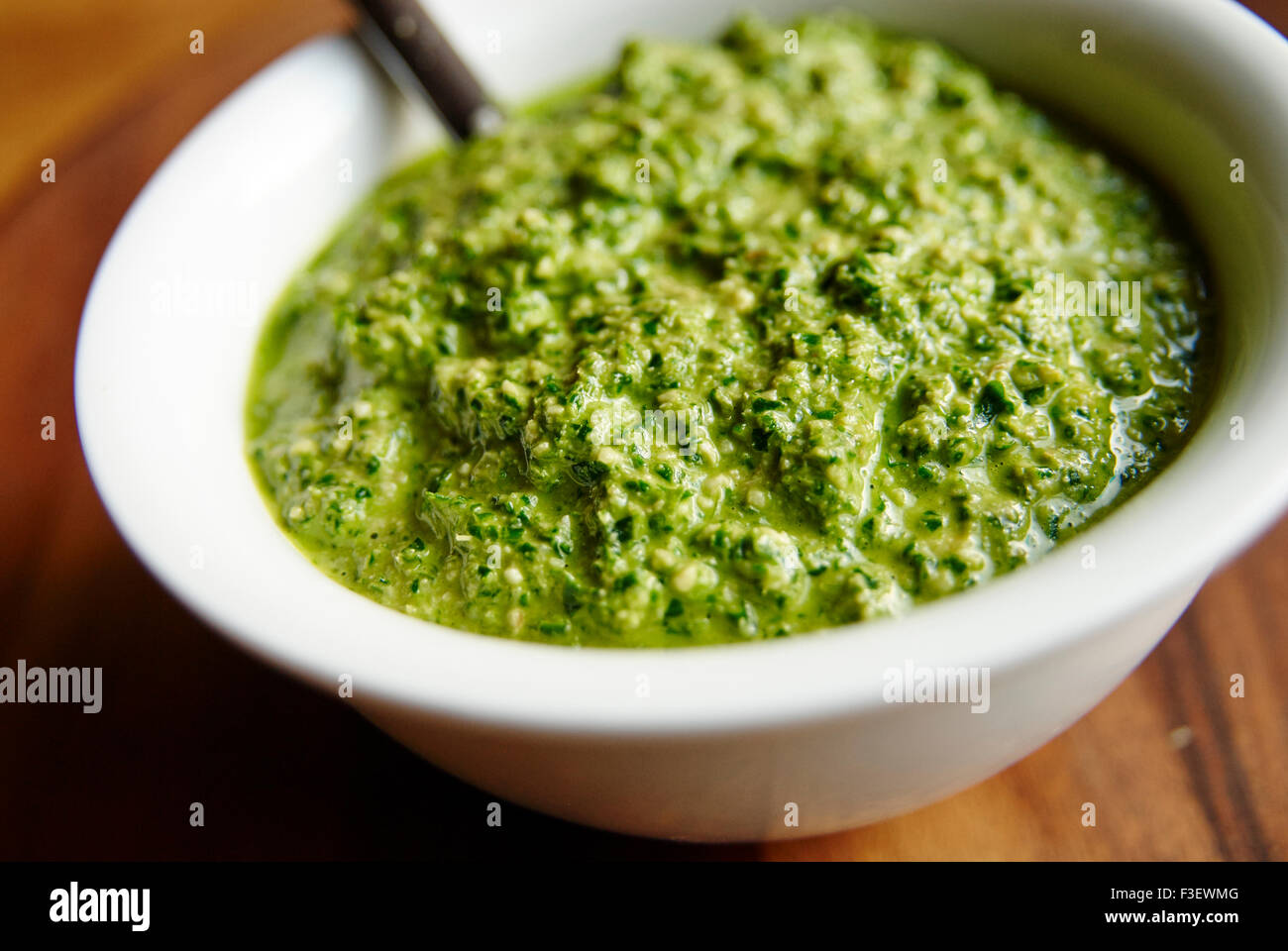 Kale pesto, made with fresh kale, walnuts, garlic, olive oil and nutritional yeast. - Stock Image