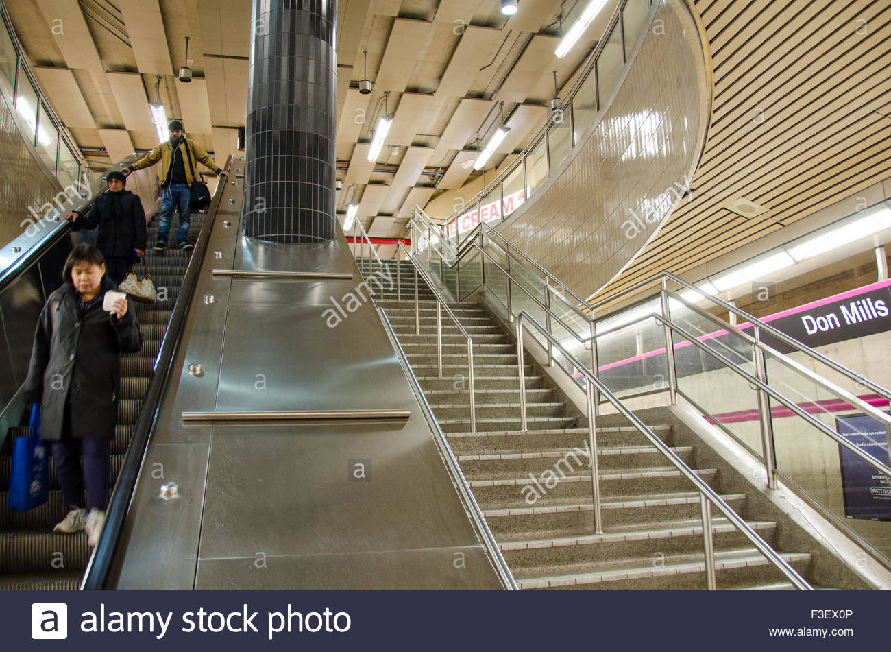 04ca672c People using the escalator in Don Mills Station. There are stairs running  parallel to the