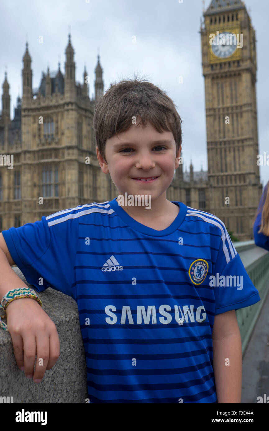 8 Year Boy Bedroom Design: 8 Year Old Boy In Chelsea Football Shirt In Front On Big