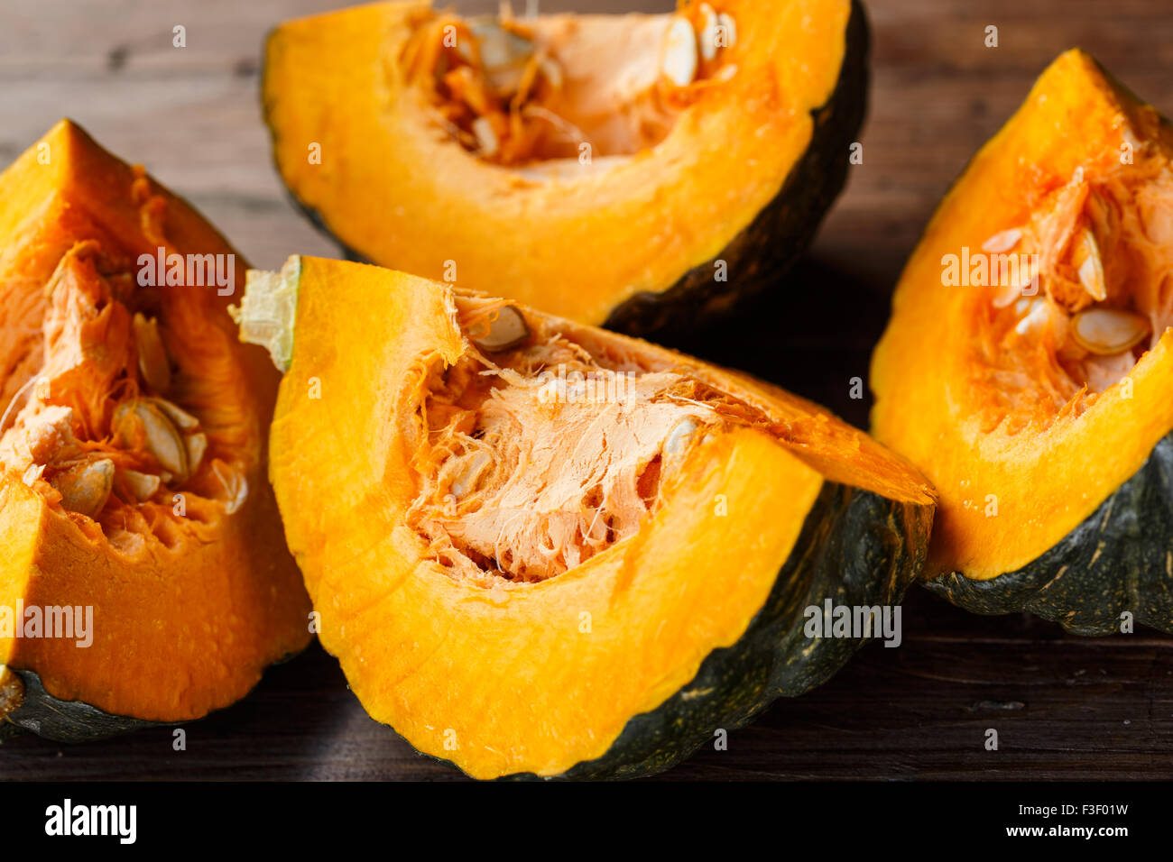 Slices of raw pumpkin - Stock Image