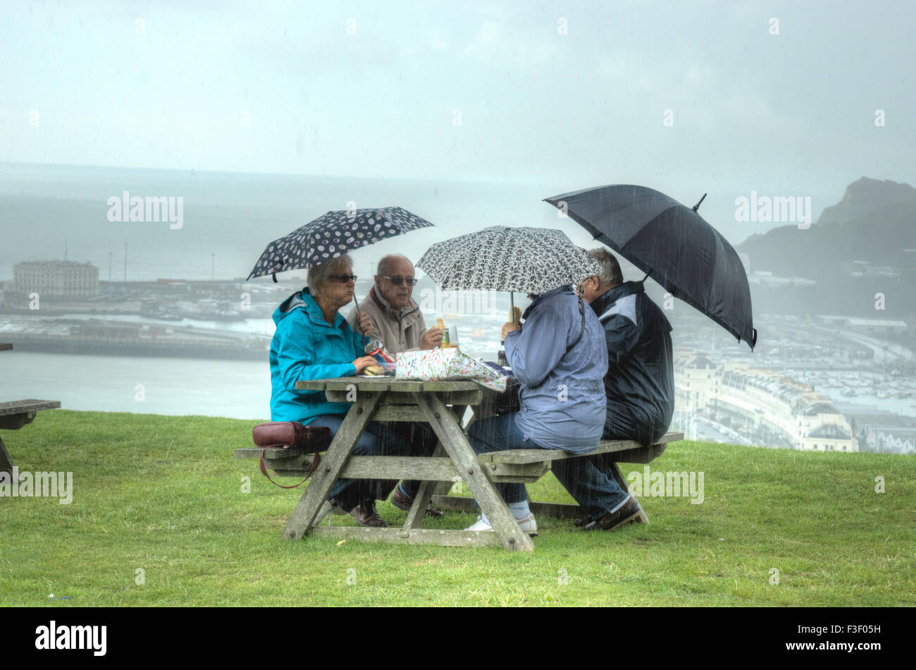 Picnic in the rain.  Picnic in bad weather.  Picnic by the sea bad weather in england - Stock Image