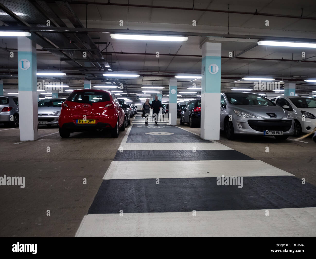 A zebra crossing in an underground multistory car park - Stock Image