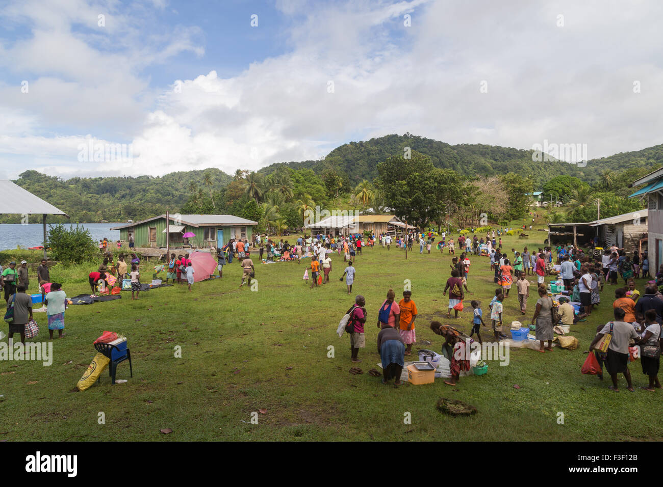 Batuna, Solomon Islands - May 28, 2015: People buying and selling food at the local market in the village of Batuna. - Stock Image