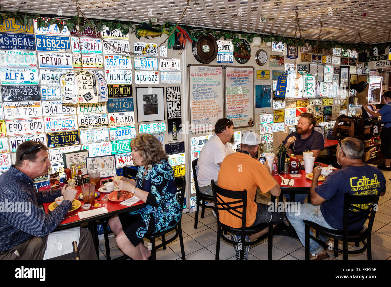 florida keys key largo mrs macs kitchen restaurant inside interior license plates decor stock - Mrs Macs Kitchen