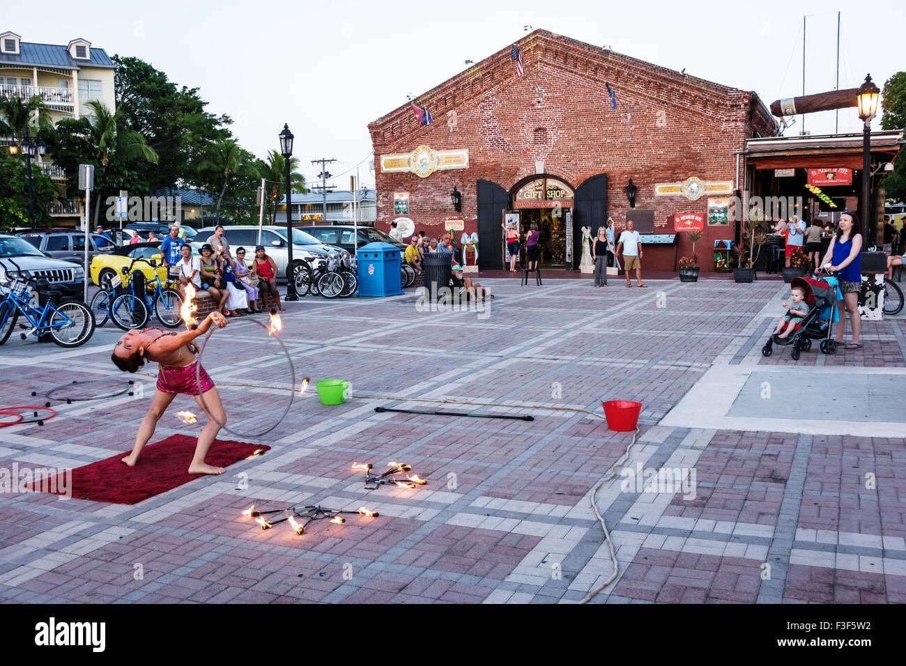 Key West Florida Keys Mallory Square Dock sunset celebration festival woman acrobat juggler lit torch torches fire - Stock Image