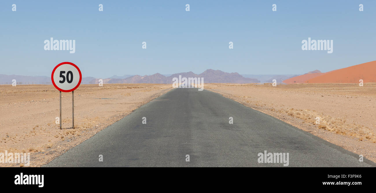Speed limit sign at a desert road in Namibia, speed limit of 50 kph or mph Stock Photo
