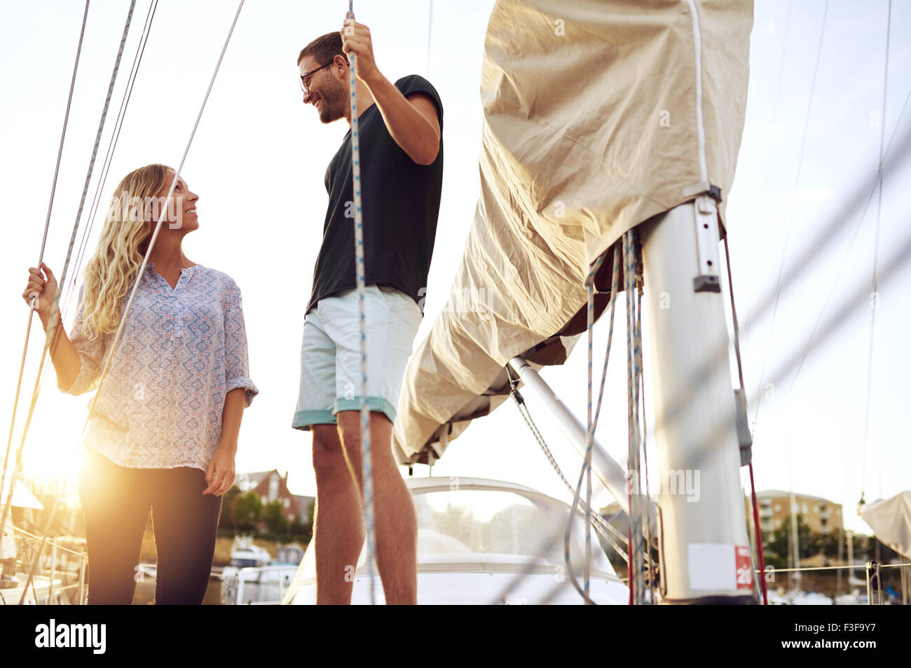Couple Bought A Boat, Looking at each Other Satisfied - Stock Image