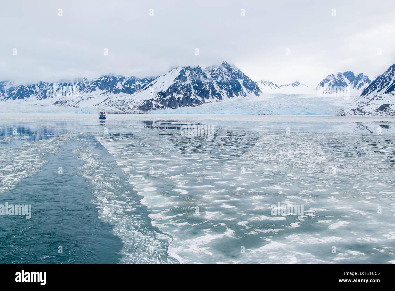 Boat in front of the Monacobreen glacier, Liefdefjorden, Spitsbergen, Norway Stock Photo