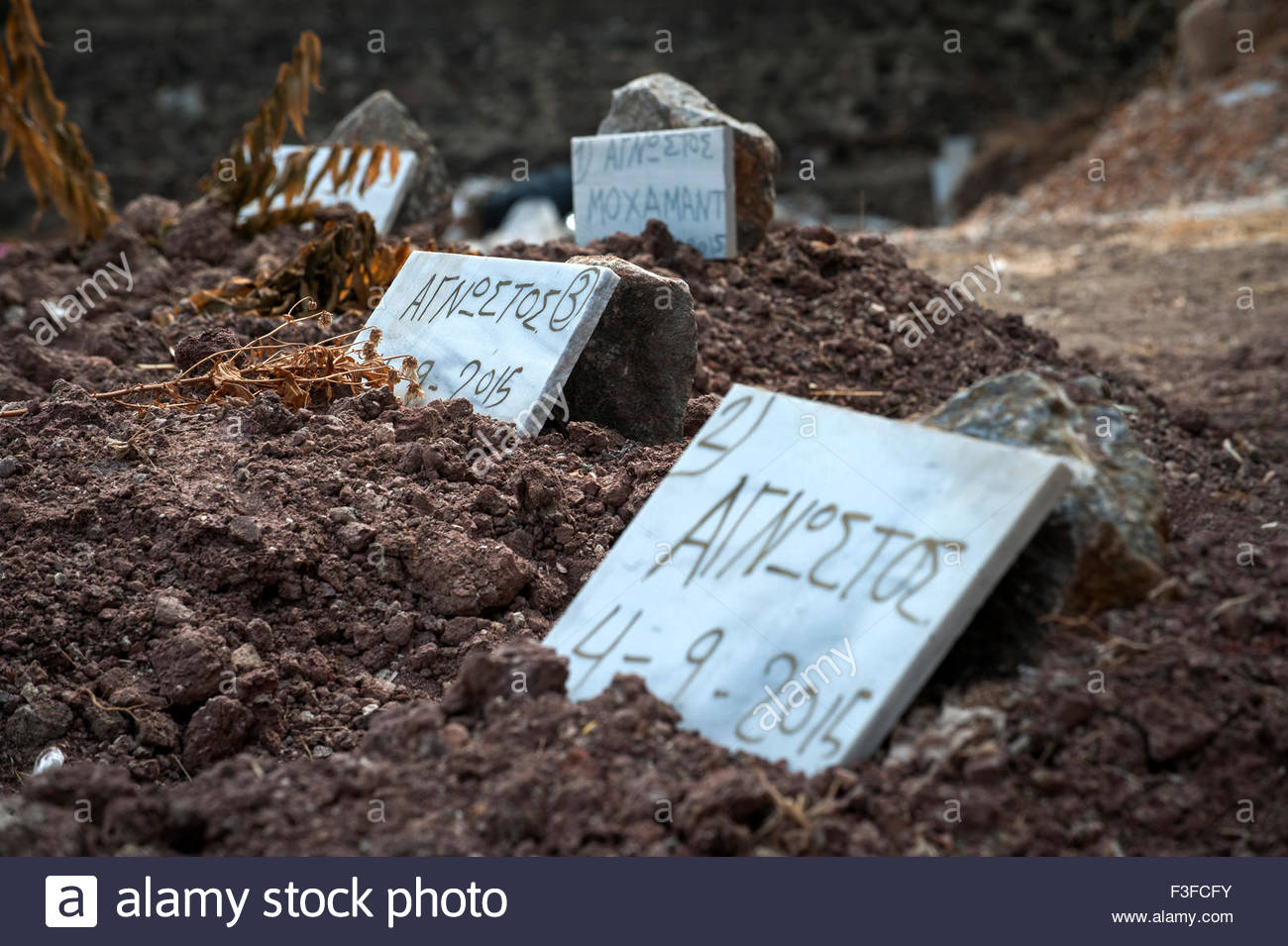 Refugee Graves at Saint Panteleimon cemetery Mytilini, Lesbos Greece. - Stock Image