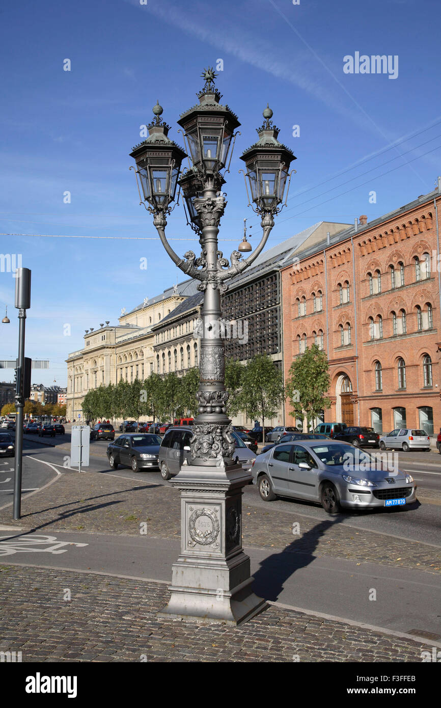 Street metal lamp post for four lamps marked 1677 in Copenhagen ; Denmark ; Scandinavia - Stock Image
