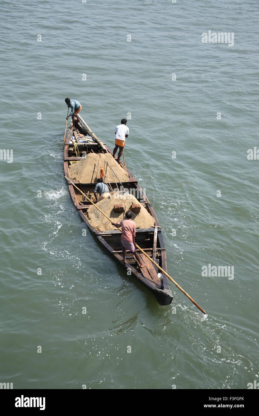 Transport sand by small boat near Chettuvai bridge