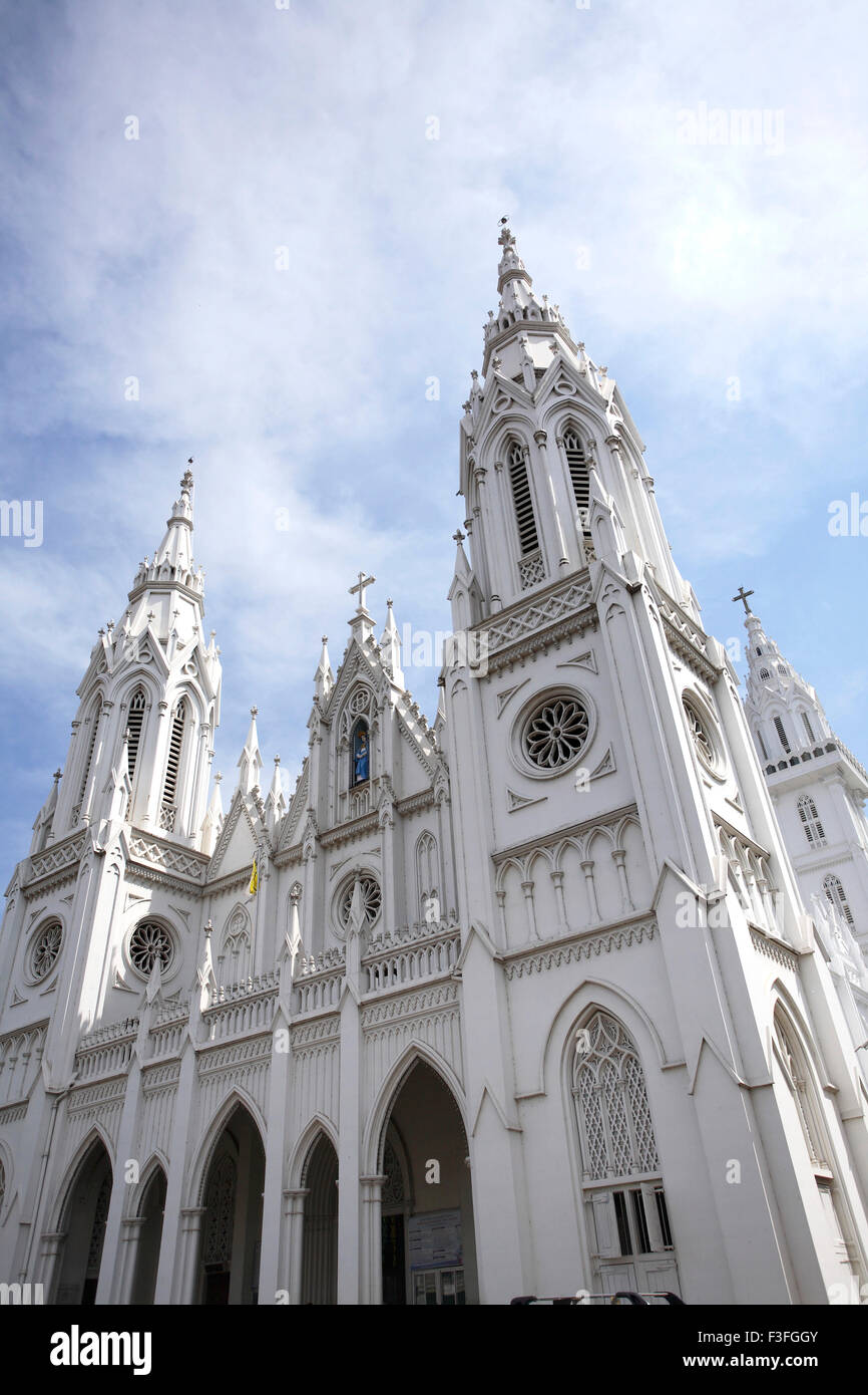 Basilica of Our Lady of Dolours 146 ft high rear Bible tower 260 feet high church Thrissur Kerala - Stock Image
