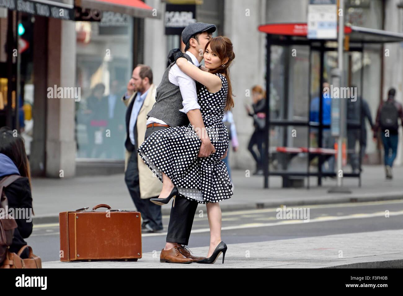 London, England, UK. Japanese couple (models) posing for a photographer in Regent Street - Stock Image