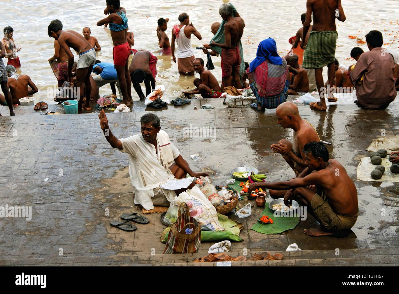 A traditional ritual as per Hindu People worship at Howrah Bridge ; Calcutta ; West Bengal ; India - Stock Image